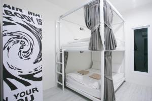 A bunk bed or bunk beds in a room at The Street Hostel