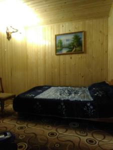 A bed or beds in a room at Lyubava Guest House