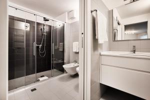 Ein Badezimmer in der Unterkunft La Perla by Sedar