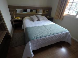 A bed or beds in a room at Pousada Serra Valle