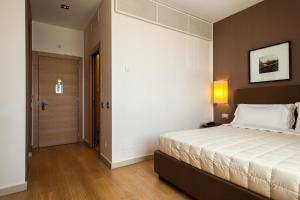 A bed or beds in a room at Marina Place Resort