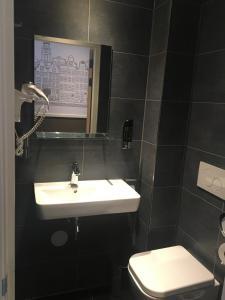 Um banheiro em Hotel Manofa