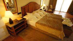 Cama o camas de una habitación en Hotel Cigarral el Bosque