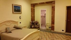 Кровать или кровати в номере Hotel Croce Di Malta