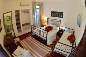 A bed or beds in a room at Pousada do Baluarte