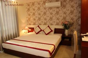 A bed or beds in a room at BIDV Hotel
