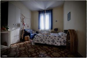 A bed or beds in a room at La Casa sul Molo