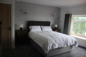 A bed or beds in a room at The New Lodge