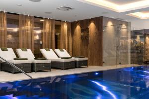 The swimming pool at or near Hotel Restaurant Spa Rosengarten