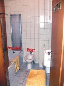 Ein Badezimmer in der Unterkunft Guest House Projade105