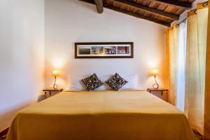 Uma cama ou camas num quarto em Monte do Serrado De Baixo