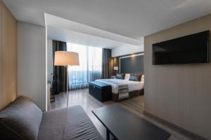A television and/or entertainment center at Catalonia Square 4* Sup