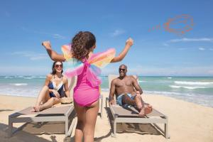 A family staying at Nickelodeon Hotels & Resorts Punta Cana - Gourmet All Inclusive by Karisma