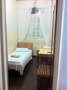 A bed or beds in a room at Hotel Brasil