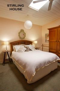 A bed or beds in a room at Crafers Cottages