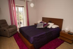 A bed or beds in a room at Quinta da Pedra Grande