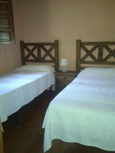 Een bed of bedden in een kamer bij Camping Genal