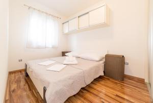 Postel nebo postele na pokoji v ubytování Apartman Dukić