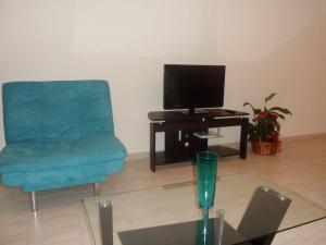 Телевизия и/или развлекателен център в Georgos Apartment