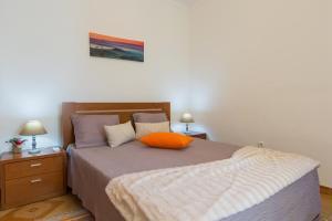 Uma cama ou camas num quarto em Quinta das Palmeiras
