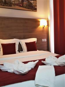 Un ou plusieurs lits dans un hébergement de l'établissement Hotel Luxor