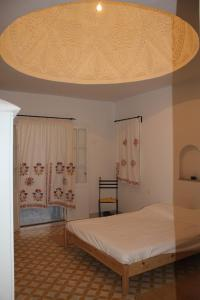 A bed or beds in a room at Villafontaine