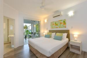 A bed or beds in a room at On The Beach 321 - Port Douglas