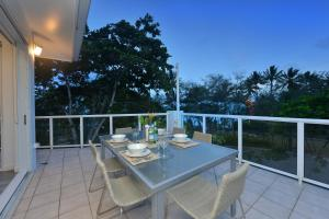 A balcony or terrace at On The Beach 321 - Port Douglas
