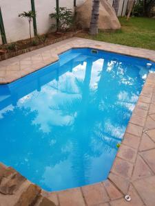 Pioneers Self-Catering tesisinde veya buraya yakın yüzme havuzu
