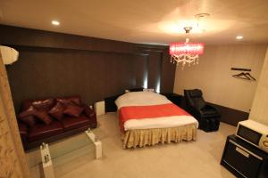 A bed or beds in a room at Hotel Sindbad Sendai(Adult Only)