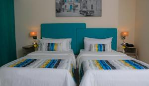 A bed or beds in a room at LABRANDA Riviera Hotel & Spa