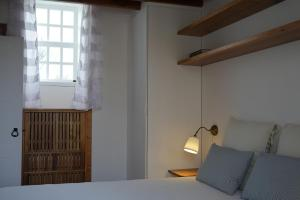 A bed or beds in a room at Canário do Mar - Rural Tourism