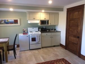 A kitchen or kitchenette at The Artisan Suites - The Woodland Suite