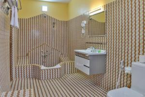 Ванная комната в Tembo Palace Hotel