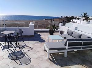 A balcony or terrace at La Concha Boutique Apartments