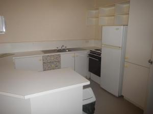 A kitchen or kitchenette at Portsea 16 14 Surf Street