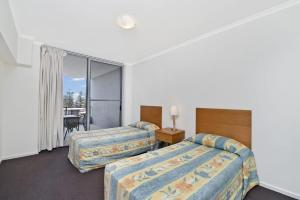 A bed or beds in a room at Ki-Ea 538 67 William Street