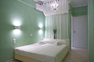 Кровать или кровати в номере Palazzo Greco
