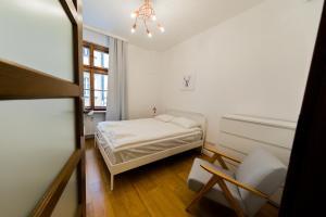 Łóżko lub łóżka w pokoju w obiekcie ZŁOTY JELONEK