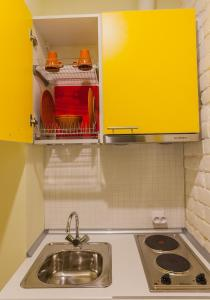 A kitchen or kitchenette at ForYou na Monetnoy Apartments