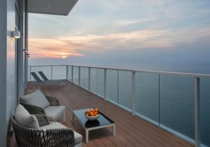 A balcony or terrace at Island Luxurious Suites Hotel and Spa- By Saida Hotels