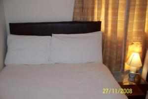 A bed or beds in a room at Hotel Citystay
