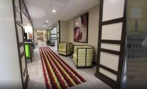 A seating area at Hampton Inn & Suites Dallas Market Center
