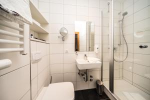 Ein Badezimmer in der Unterkunft Parkhotel Pyrmont