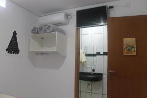 Um banheiro em Pousada Orquideas de Maria
