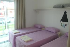 Cama ou camas em um quarto em Pousada Orquideas de Maria