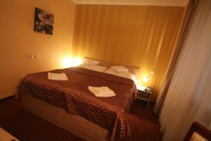 A bed or beds in a room at Hotel CITY **** Galanta
