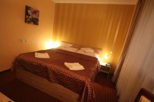 Posteľ alebo postele v izbe v ubytovaní Hotel CITY **** Galanta
