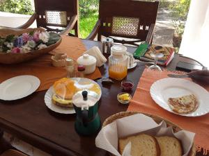 Breakfast options available to guests at Villa Mela Hotel