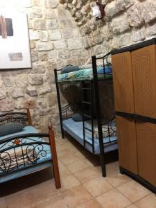 A bunk bed or bunk beds in a room at Chain Gate Hostel